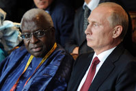 Russian President Vladimir Putin and IAAF President Lamine Diack attend the opening ceremony for the World Athletics Championships at the Luzhniki Stadium in Moscow in Aug. 10, 2013.