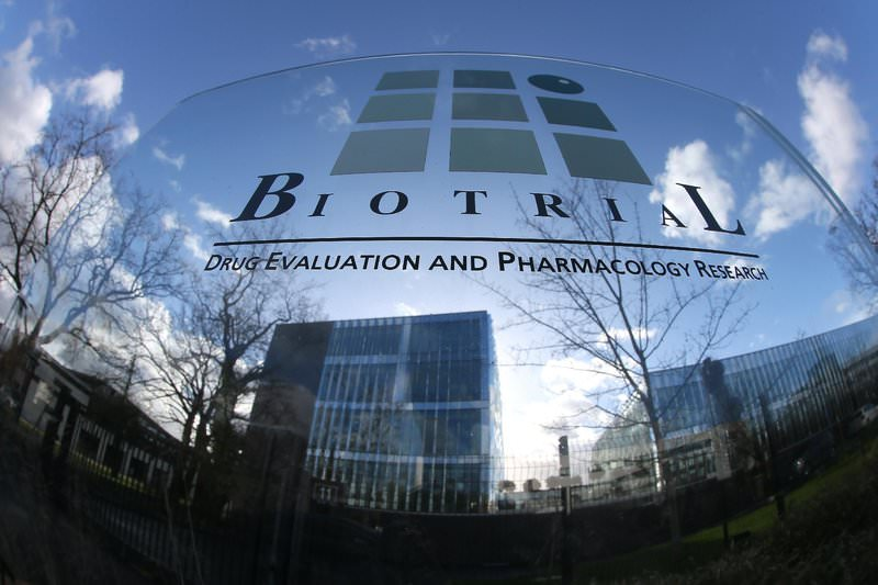A logo of the Biotrial laboratory is displayed outside its building in Rennes, western France, Friday, Jan. 15, 2016. (AP Photo)