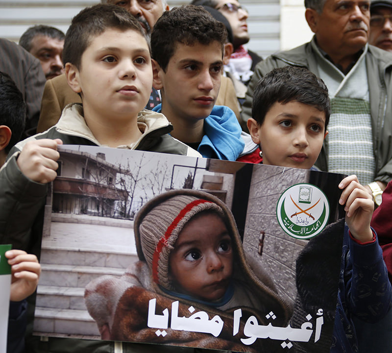 Children protest to save Madayans in front of the International Red Cross headquarters in Beirut, Lebanon. (EPA Photo)
