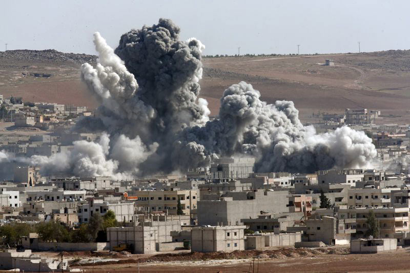 Smoke rises over Syrian town of Kobani after a US-led coalition airstrike, October, 2014. (AP Photo)