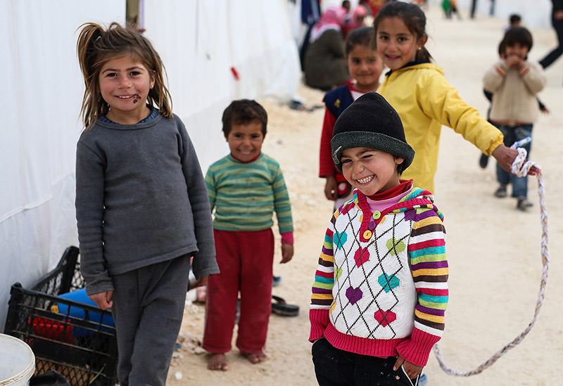 A Friday, Jan. 30, 2015 file photo showing Syrian refugee children who fled violence in the Syrian city of Ayn al-Arab or Kobani seen outside their tent in Turkeyu2019s newly set-up camp in the border town of Suruu00e7 (AP Photo
