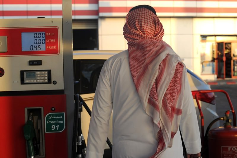 A Saudi man walks past a pump at a petrol station in the Red Sea city of Jeddah. Saudi Arabia raised the prices of heavily-subsidized power and fuel by as much as 40 percent as part of new measures introduced in the face of low oil prices.