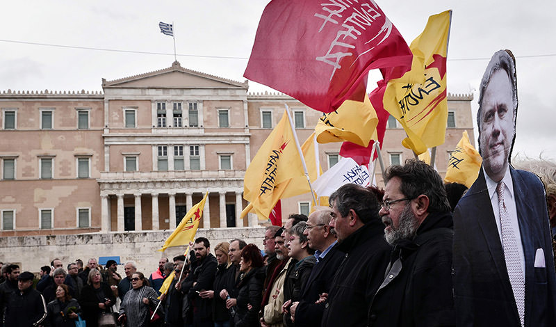 Greek workers marched through the streets of Athens on Saturday to protest against the leftist-led government's planned pension reform, which the country's international creditors have demanded as part of its third bailout. (AFP Photo)