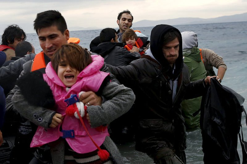 Refugees and migrants arrive on an inflattable raft at the Greek island of Lesbos.