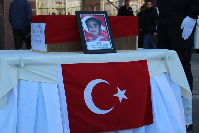 The Coffin of Mevlu00fcde u0130rem was draped in a Turkish flag at a funeral ceremony yesterday. The young girl was among the youngest victims of PKK violence which also killed 5-month-old Ecrin and her brother Murat.