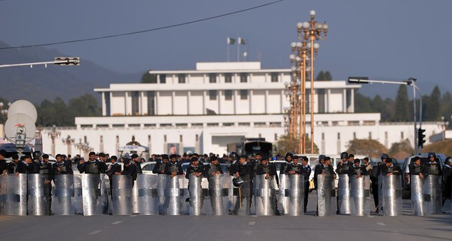 Pakistani riot police block a street leading to the President House during a protest by Shiite Muslims in Islamabad against the Pakistani government's decision to join a Saudi-led military coalition.