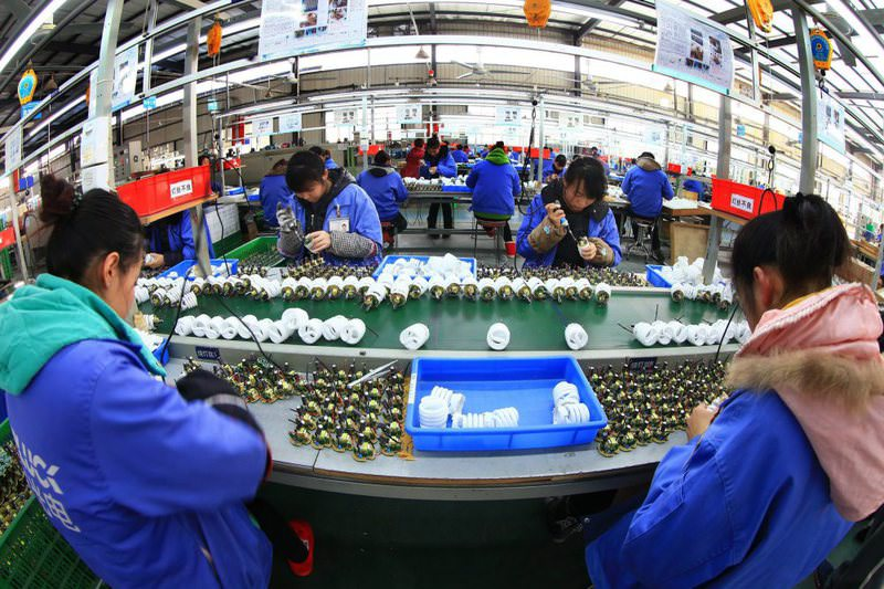 Women work on the production line of energy-saving lamps in a factory in Suining in southwest China's Sichuan province. China allowed the Chinsese official Renminbi currency to weaken further amid efforts to save its weak economic growth.