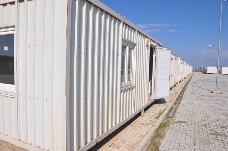,Container city, under construction. This new type of refugee camp offers modern accommodation facilities for Syrian refugees.