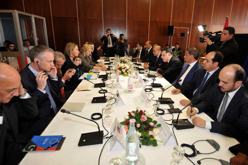 Libyan Prime Minister Fayez al-Sarraj (4th L) and EU foreign policy chief Federica Mogherini (4th R) attend the talks between EU and Libya delegations in Tunis.