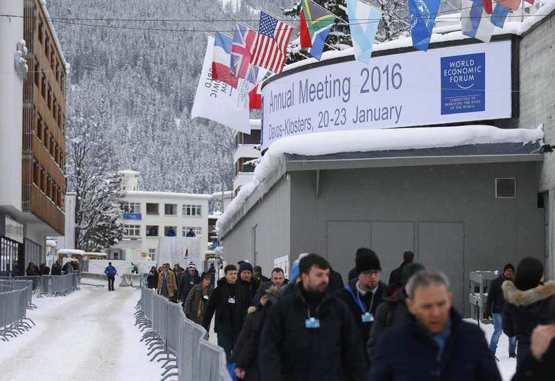 Attendees walk outside the Congress Center during the Annual Meeting 2016 of the World Economic Forum (WEF) in Davos, Switzerland yesterday.