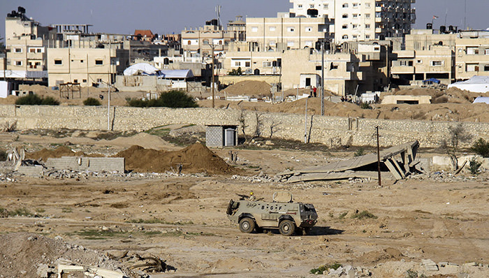 Egyptian army armored vehicle stands on the on the Egyptian side of border town of Rafah, north Sinai, Egypt. (AP Photo)
