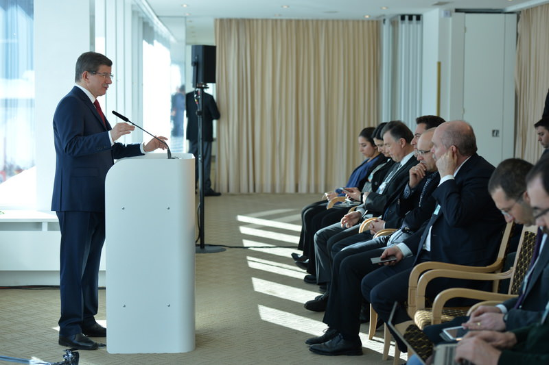 Prime Minister Davutou011flu (L) at a press meeting in Davos, where he is attending the World Economic Forum.