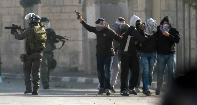 undercover israeli security personnel detain a palestinian protester during clashes with israeli troops in the west