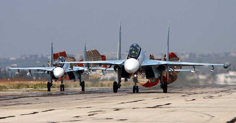 picture taken on October 3, 2015 shows Russian Sukhoi SU-30 SM jet fighters landing on a runway at the Hmeimim airbase in the Syrian province of Latakia (AFP Photo)