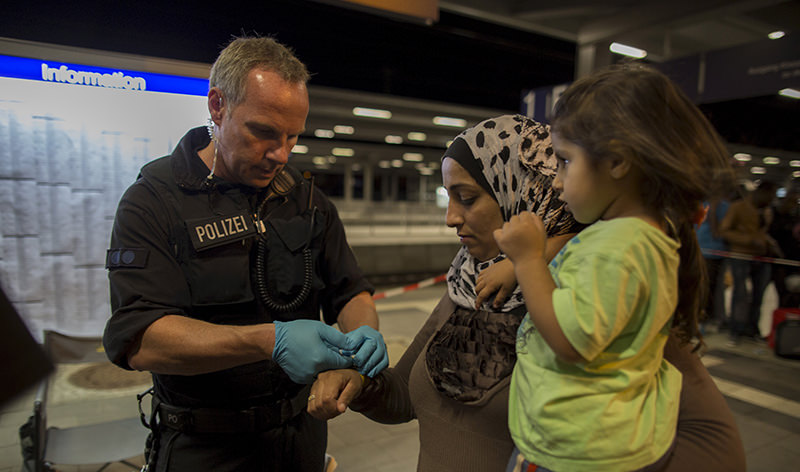 Wristbands have also been used for different purposes in Germany and other European states to identify refugees (Reuters Photo)