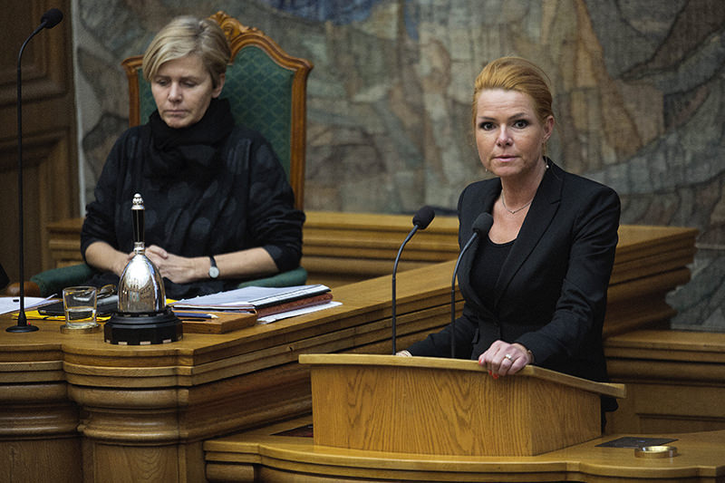 Minister of Integration from Inger Stoejberg, right, and Mette Bock attend Parliament, in Copenhagen on Jan. 26, 2016. (AP Photo)