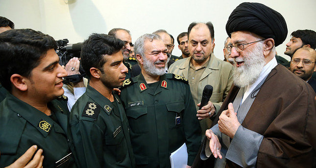 Iran's Supreme Leader Khamenei (R) greeting a group of Revolutionary Guard officers, who were involved in the detention of US Navy sailors earlier this month. (AFP Photo)