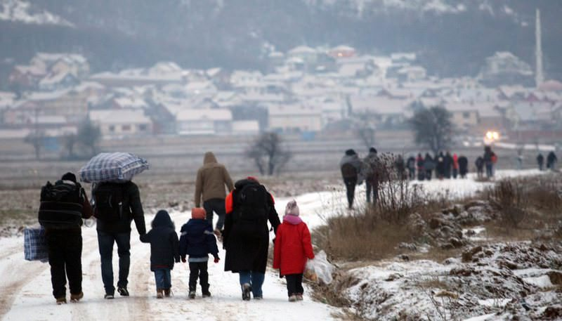 A group of Syrian refugees walking in very cold weather from Macedonia to a camp for the temporary acceptance of refugees in the village Miratovac, on the border between Serbia and Macedonia.