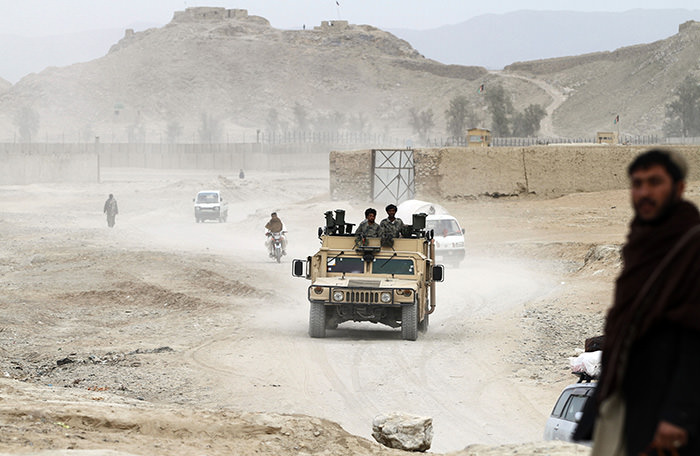 Afghan security forces drive an army vehicle in Spein Boldak in the border with Pakistan, Kandahar province, Afghanistan, Jan. 25, 2016 (AP Photo)