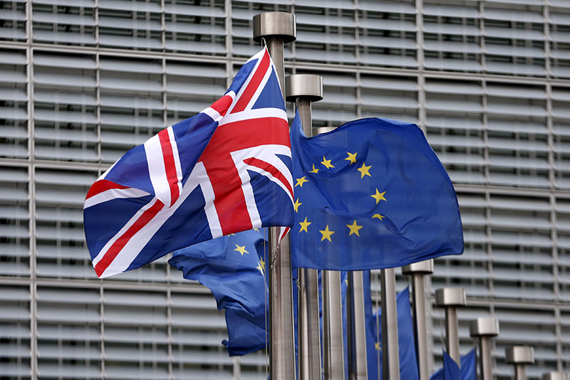 Union Jack flag flutters next to EU flags ahead of a visit from Britain's Prime Minister David Cameron at EU Commission headquarters in Brussels (Reuters)