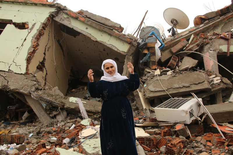 A resident gesturing as she talks standing on the rubbles of a house destroyed by PKK militants in the predominantly-Kurdish town of Silopi, in southeastern Turkey.