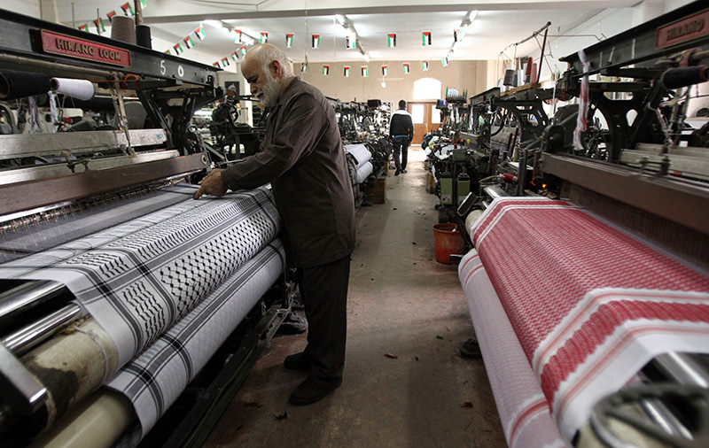 alestinian Yasser Al-Hirbawi, the owner of the Palestinian factory which locally produces traditional black-and-white keffiyeh headscarf (AFP Photo)