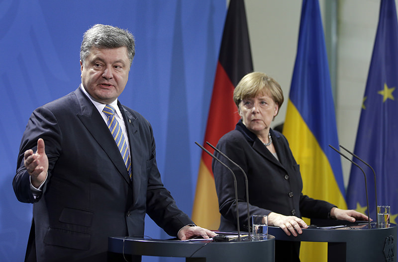 Angela Merkel, right, and Poroshenko, left, address media during joint statement as part of meeting at chancellery in Berlin, Germany, Feb. 1, 2016. (AP Photo)