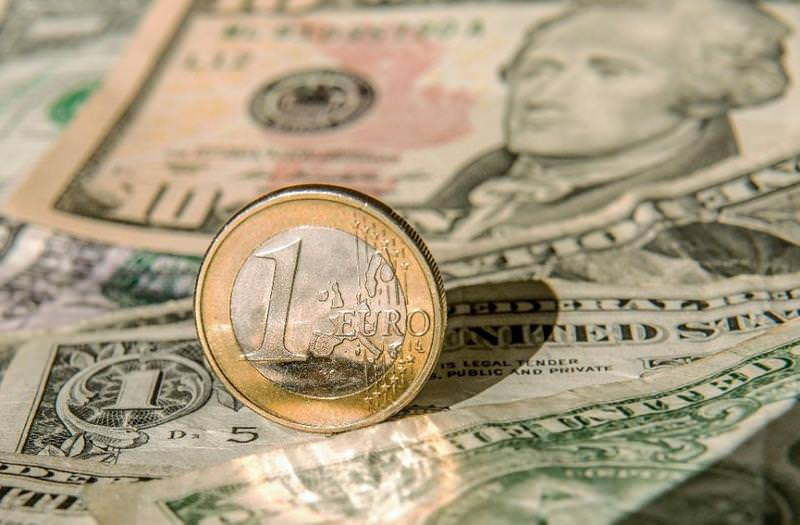 The U.S. dollar hit its lowest level against the euro since October and wiped out recent gains against the yen. (AFP Photo)