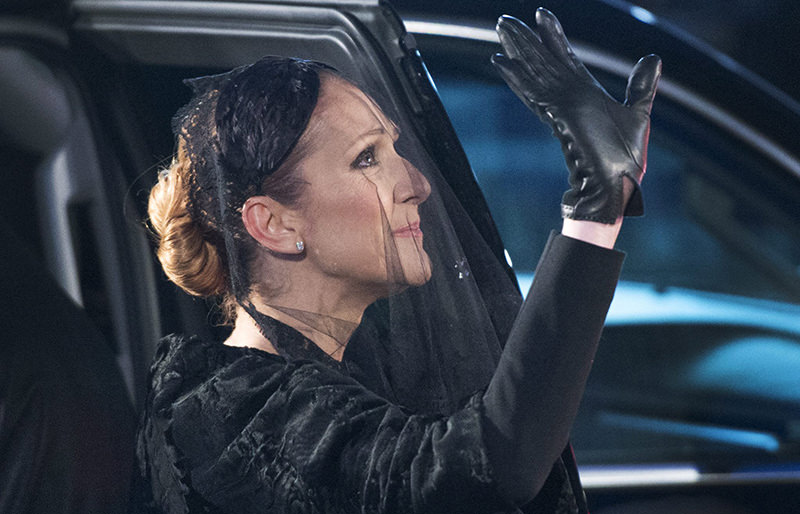 Celine Dion waves after funeral services for Rene Angelil at Notre-Dame Basilica Friday, Jan. 22, 2016 in Montreal (AP Photo)
