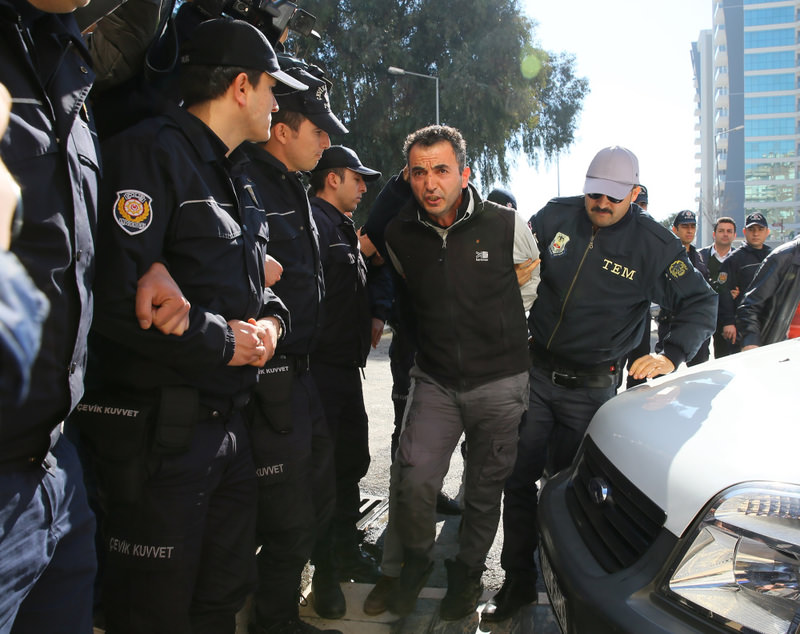 Suspect u0130smail Akkol being accompanied by policemen to a police station in the city of Aydu0131n. Akkol and fellow DHKP-C member Fadik Adu0131yaman were captured at a bus station.
