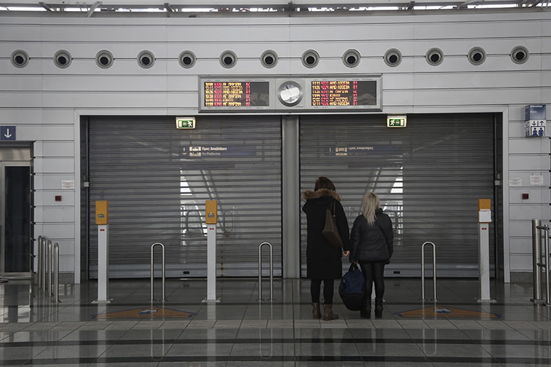 Women stand in front of closed suburban station at Athens airport during a 24-hour national strike, in Athens Greece, 04 Feb 2016. (EPA)