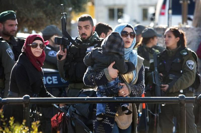 Israeli police stop Palestinians at the Damascus Gate in Jerusalem for search as attacks have increased.