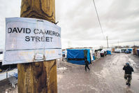 British PM Cameron referred to the refugees living in the terrible conditions at the camp in Calais as a bunch of migrants; however, one of the streets in Calais is named after him, hoping that they can reach the U.K. one day. (AFP Photo)