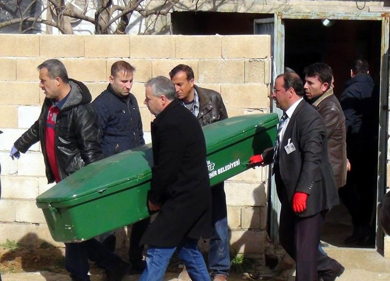 As bodies in coffins were carried away to be autopsied, police escorted family members of the suspect to safety after he threatened to kill more family members. (IHA Photo)