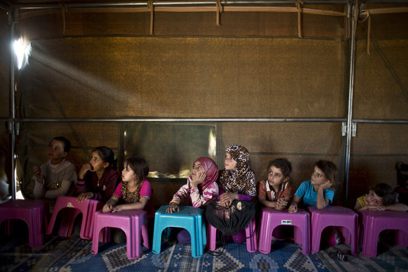 Syrian refugee children attending a class at a makeshift school set up in a tent near the Syrian border on the outskirts of Mafraq, Jordan. (AP Photo)