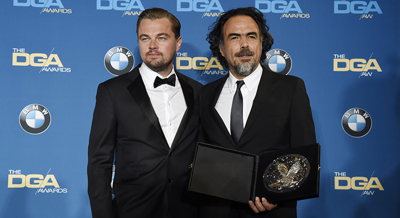 Leonardo DiCaprio, left, star of ,The Revenant,, poses backstage with the film's director Alejandro Gonzalez Inarritu at the 68th Directors Guild of America Awards (AP Photo)