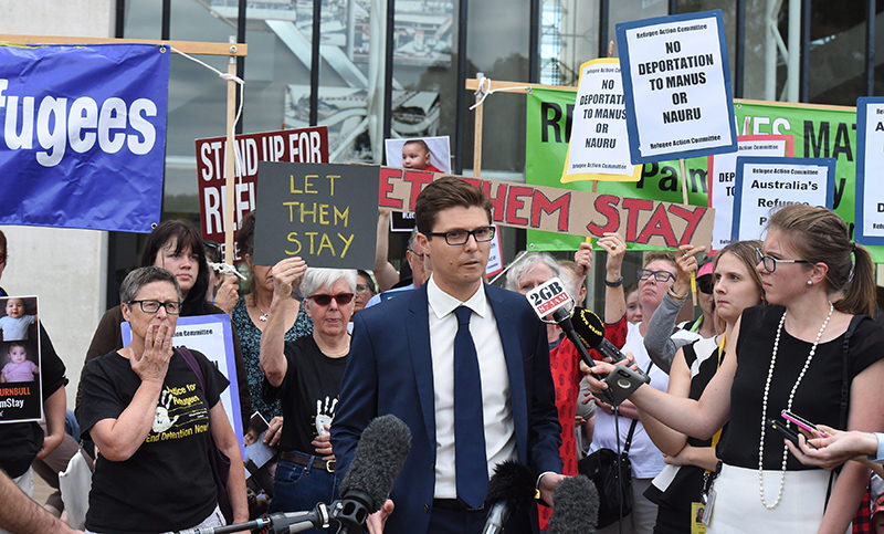Daniel Webb (C) from the Human Rights Law Centre speaks to the media after the High Court of Australia ruling on refugees to Nauru in Canberra, Australia (EPA Photo)