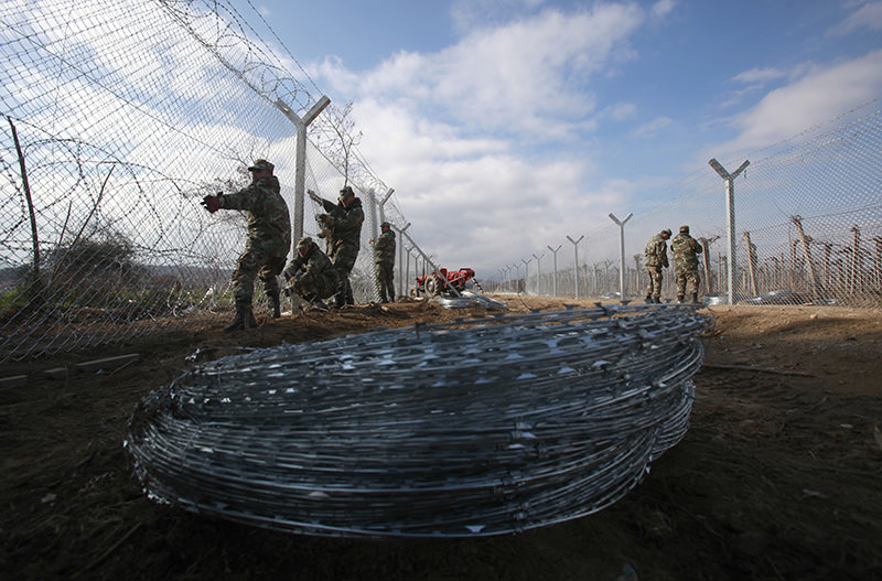 Macedonian army soldiers erect second fence on border line with Greece, near southern Macedonia's town of Gevgelija, Feb. 8, 2016. (AP)