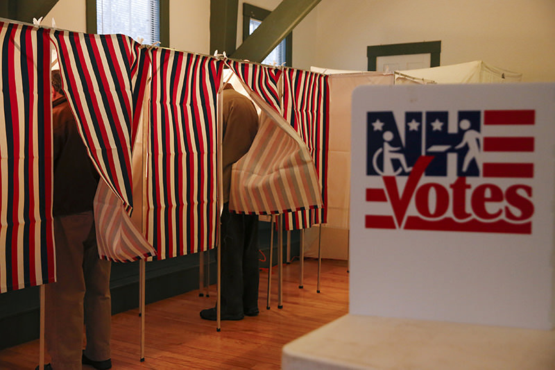 People vote at a polling place at the Canterbury Town Hall polling station in Canterbury, New Hampshire February 9, 2016 (Reuters Photo)