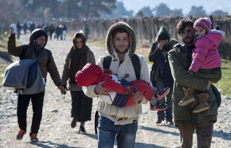 Refugees walk to a transit camp after they crossed the border between Greece and Macedonia near Gevgelija, Macedonia, Feb. 7.