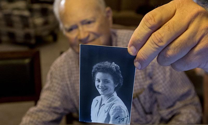 In this Nov. 6, 2015 file photo, Norwood Thomas, holds up a photo of with Joyce Morris at his home in Virginia Beach, Va. (AP)