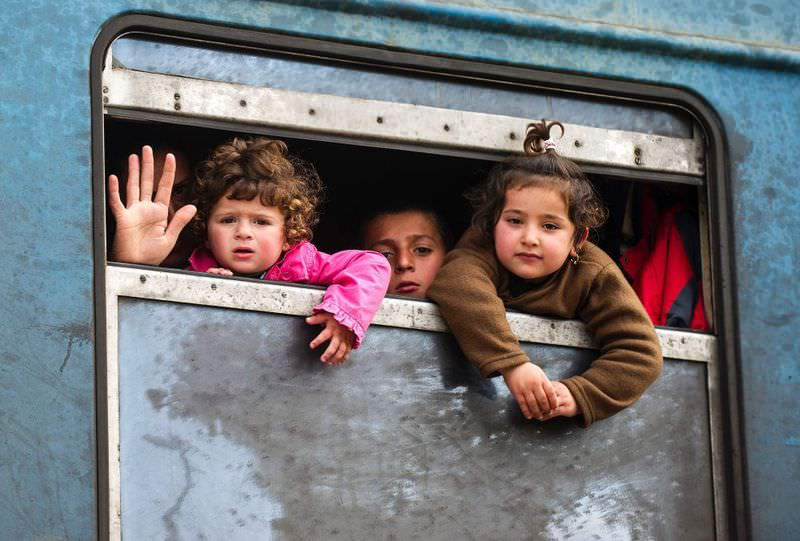 Migrants look out of the window from a train heading to Serbia at the border between Greece and Macedonia near the town of Gevgelija on Feb. 8.