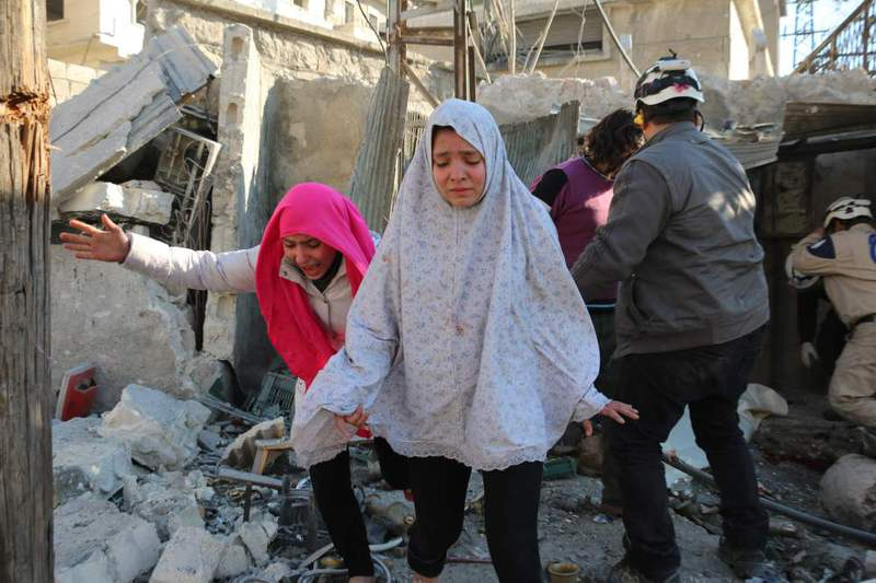Syrian girls react following a reported Syrian regime airstrike in a rebel-controlled area in the northern city of Aleppo on Feb. 8.