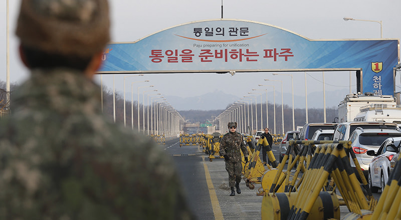 A South Korean army soldier walks on Unification Bridge, which leads to the demilitarized zone, near the border village of Panmunjom in Paju, South Korea, Thursday, Feb. 11, 2016 (AP Photo)