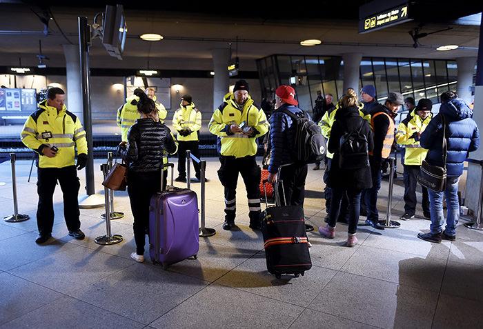 Security staff check IDs at Kastrups train station outside Copenhagen, Denmark, 04 January 2015. (EPA Photo)