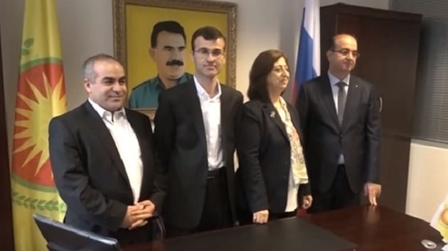 The PKK-affiliated PYD opened a representative office in Moscow last week, with a portrait of imprisoned PKK leader u00d6calan on the wall (right)