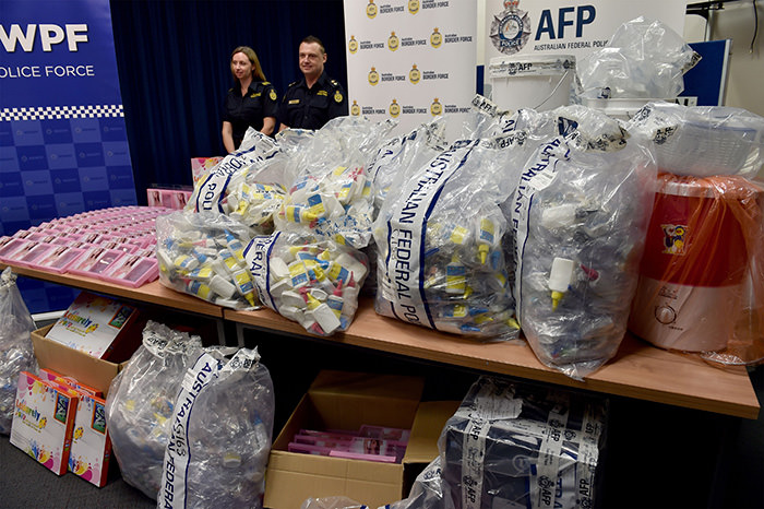 Border Police officers stand next to a haul of crystal methamphetamine concealed in packaging at the Australian Federal Police HQ in Sydney on February 15, 2016 (AFP Photo)