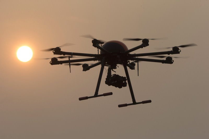 A drone hovers with the sun in the background near a school run by TT Aviation Technology in Beijing.