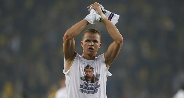Locomotiv Moscow's Dmitri Tarasov features an inner shirt with a picture of Russian President Vladimir Putin and the slogan The most polite President. (AP Photo)