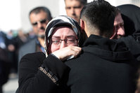 Family members of victims comfort each other outside the medical forensics site in Ankara, Turkey , Feb. 18, 2016 (AP)